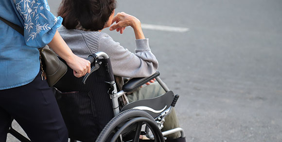 Picture of elderly hospital patient being wheeled out from hospitals and into care homes in the second wave of coronavirus